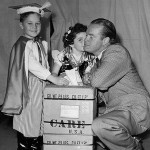 Bob Hope in Poland with children dressed in European costumes.