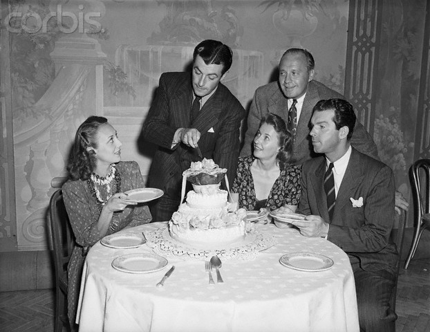 Robert Taylor Birthday with Ann Dvorak, Barbara Stanwyck; Jack Benny (standing); and Fred MacMurray.